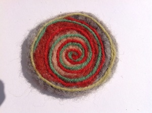 Continue until you have your desired effect. You could add beads etc. remember to add a clip on the reverse. Happy felting.