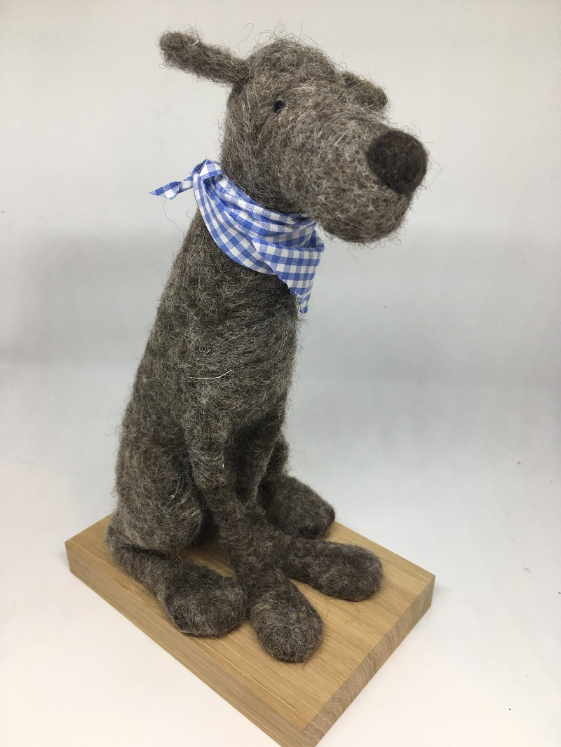 Grey dog with checked neck scarf