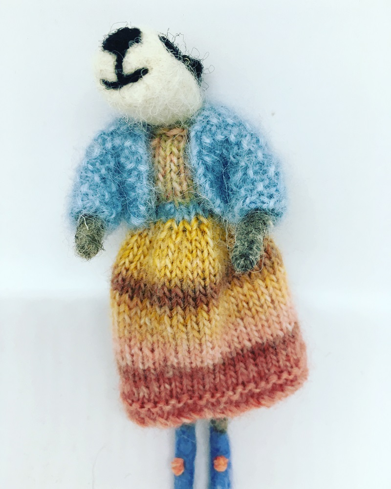 Badger in striped knitted dress