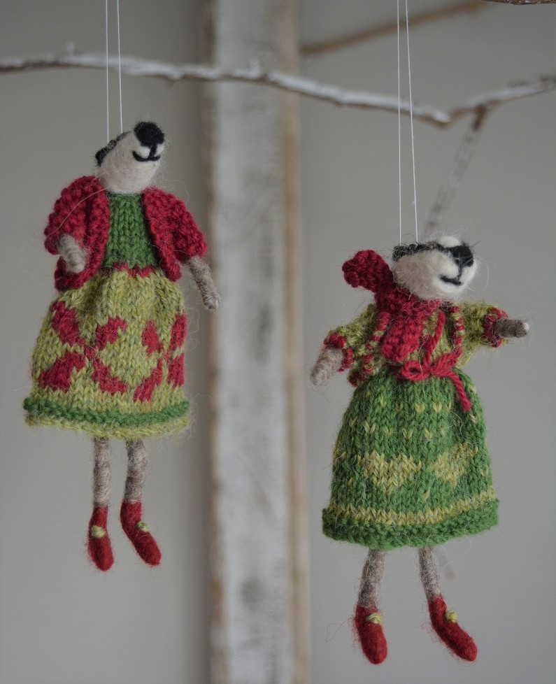 Badgers in knitted dress and jacket