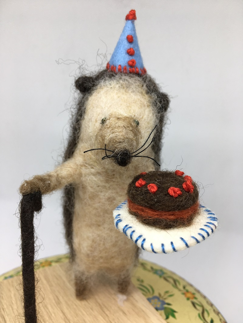 Felted Hedgehog with cake and hat