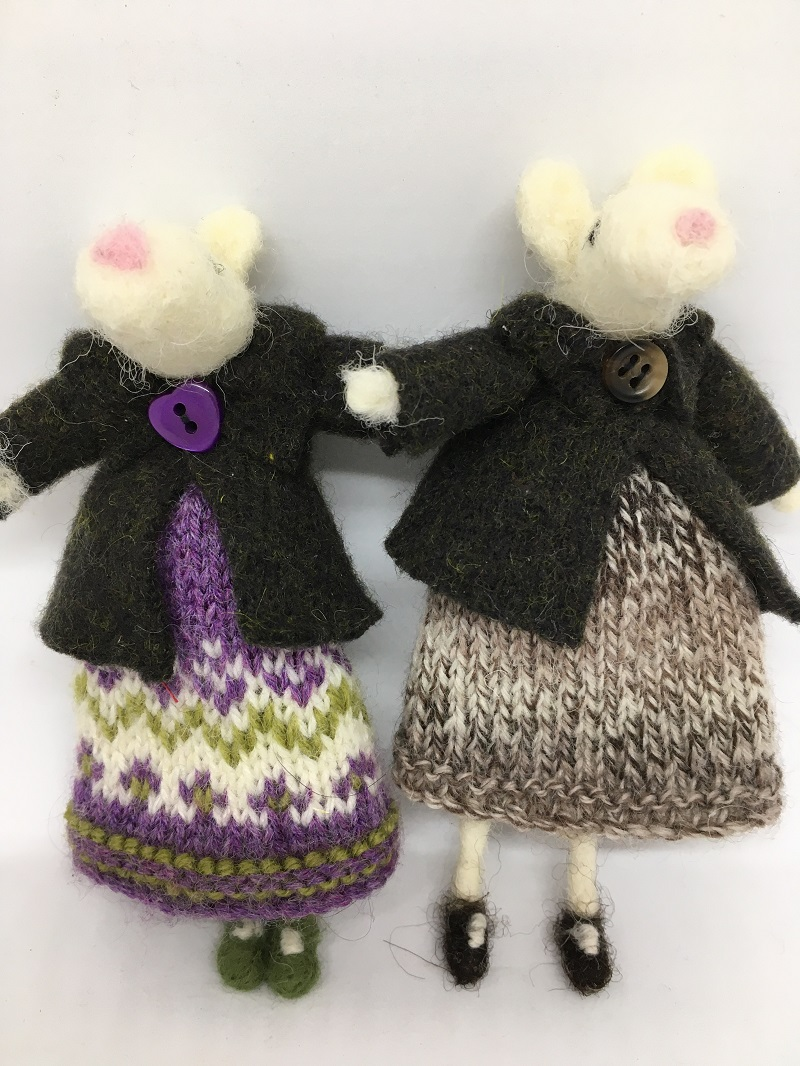 Mice in knitted dresses