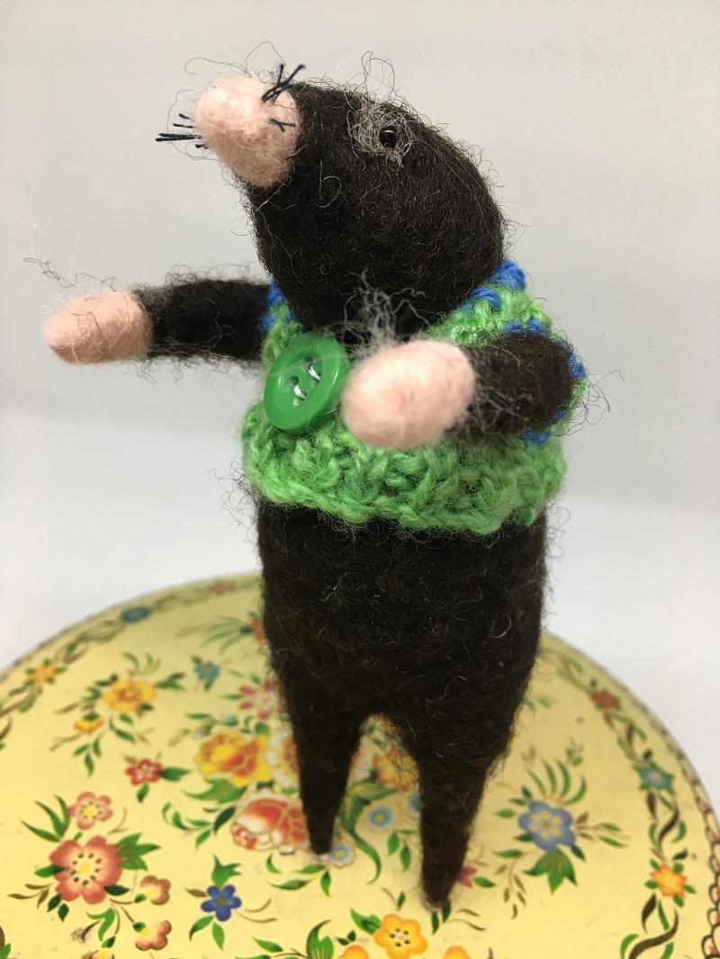 Felted mole in green jumper