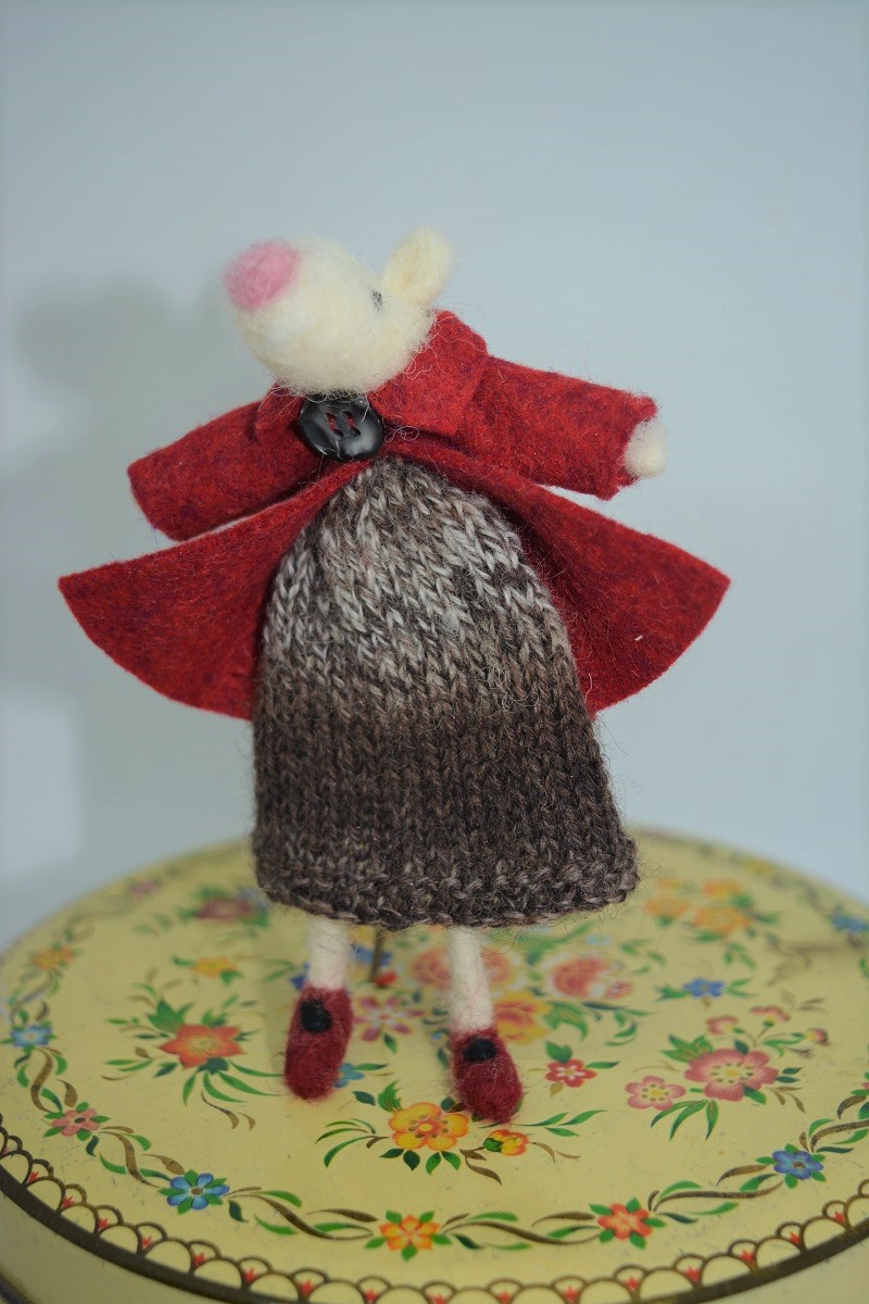 Mouse in knitted dress and red jacket