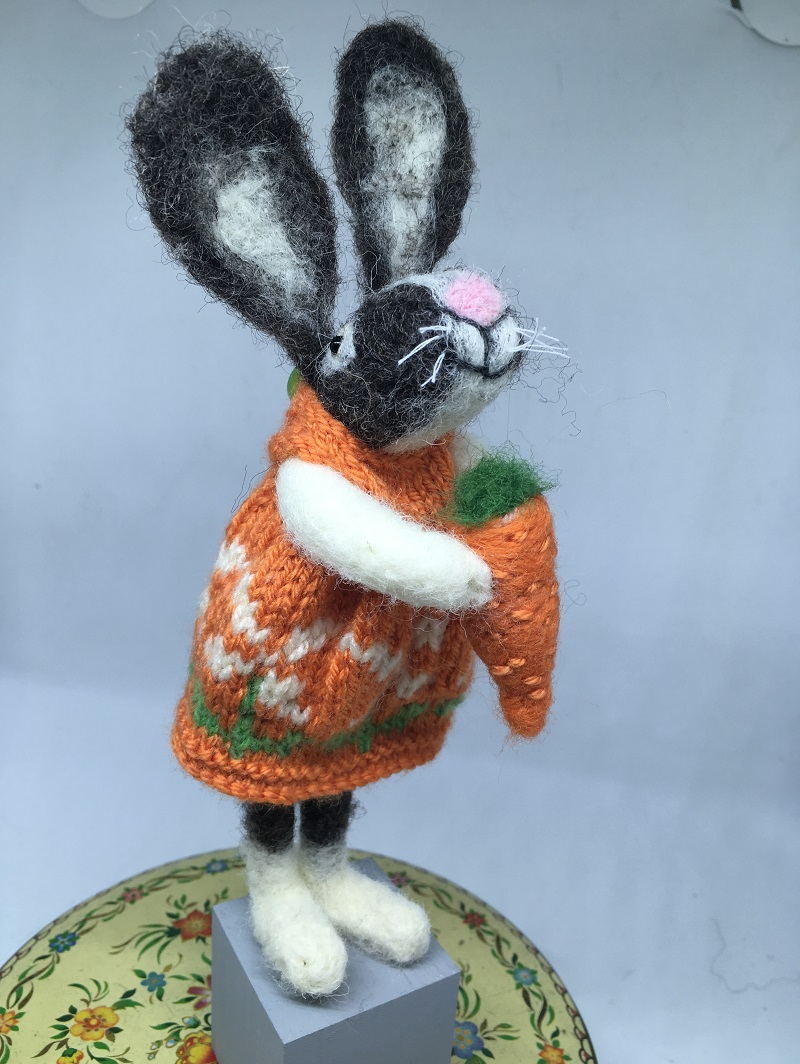Felted rabbit in orange dress